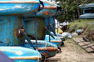 abandoned boat blue pedal boat vintage color water