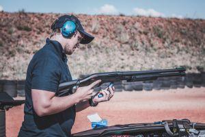 adult firearm guy blur weapon ammunition offense dangerous reload man