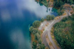 aerial trees water environment aerial photography road nature aerial view roadway asphalt