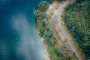 aerial view woods trees expressway asphalt aerial aerial photography curve water road