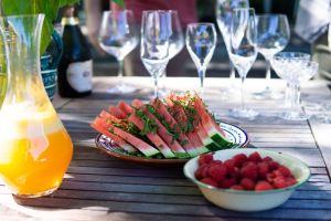 alcoholic beverage drinks wine glasses lberriesiquor wooden table plate bottle watermelon glass wine bottle