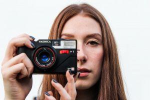 beautiful woman taking photo camera female person
