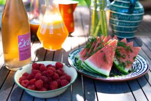 beverage plate nutritious refreshing jar slices wooden table cold drink berries sunshine