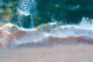 bird's eye view aerial shot seascape waves seashore ocean sea from above beach shore