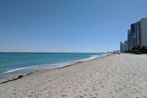 blue water landscape sand beach seashore blue sky