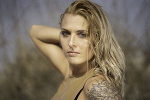 blur looking attractive tattoo depth of field blonde lady portrait woman photoshoot