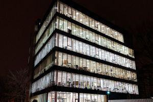 building dark lights transparent office building glass windows night