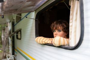 campervan lifestyle facial expression portrait sad person pretty young indoors inside