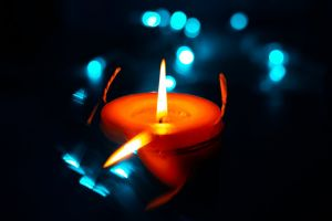 candlelight burn warmly flame illuminated adult lighted light dark burnt