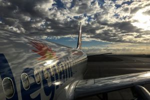 cloud sunrise reflections airliner airplane airport sky