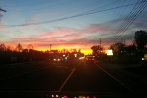clouds power lines cars night traffic sunset road
