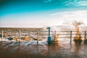 coast fence pier storm ocean seashore wet waves sea water splash