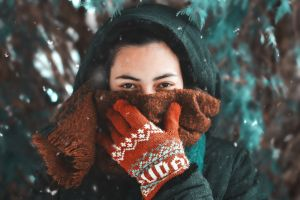 cold covered gloves female snowy hoodie lady focus snow winter clothing