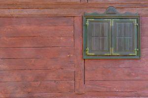 cottage village weathered exterior brown wooden house design facade glass detail