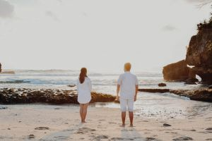 #couple #beach #dramatic water #sea #white people #people indonesia sky #landscape