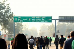 daylight pakistan information board people border daytime india road walking