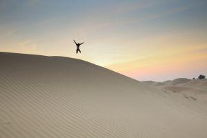 desert daylight action wasteland jump shot person adventure sunset fun landscape