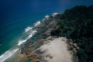 drone shot drone photography sea waves tropical daylight bird's eye view aerial photography shoreline rocky