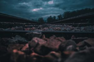 earth rocks blue clouds strom train track dark low angle photography red darkness