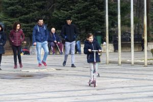 families children little girl pavement trees nature benches winter people walking in park