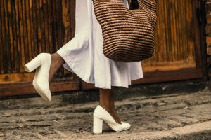 fashionable young girl daytime casual female legs white dress wear white shoes pose