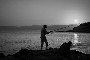 fishing sunset nature by the sea fisherman evening sun