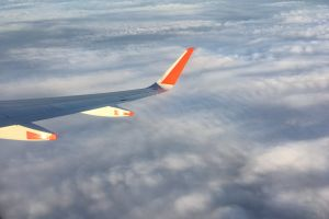 flying jetstar plane clouds