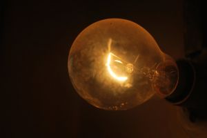 focus bright bulb lightbulb lamp energy light glass dark image filament