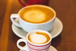 focus delicious porcelain mug coffee saucer foam brown mocha close-up