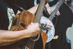 focus musical instrument hand guitarist performer guitar strumming performance music depth of field