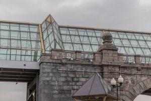 grey sky glass bridge
