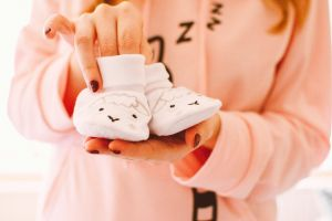hands adult baby shoes woman cute