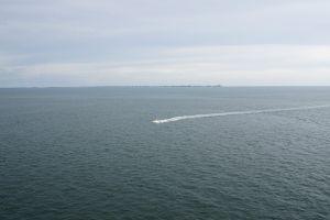 horizon blue cruise boat sky wake sea