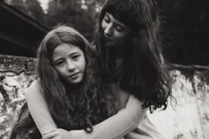 love hug beautiful kid family people embrace sisters girl facial expression