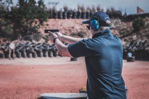 male blur shoot firing adult pistol gun action handgun man