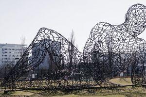 metal art cityscape trees artistic giant buildings grass winter big man sky
