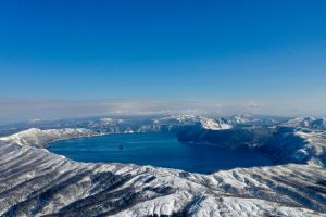 mountains freezing lake mashū japan snow capped mountains akan national park hokkaido snow