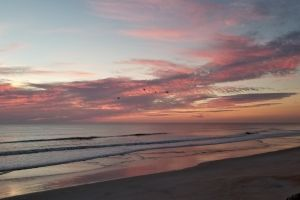 ocean clouds sunrise seaside beach sunrise beach pastel sunrise beach
