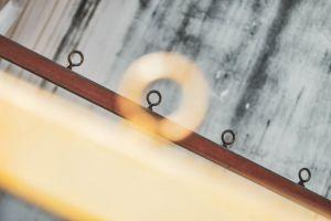 outdoor inside blur contrast depth of field pattern light and shadow linear back metal rail