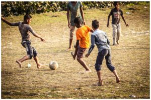 outdoor photography street children football players