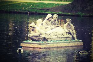 park men in a boat water sailing art monument ducks statues