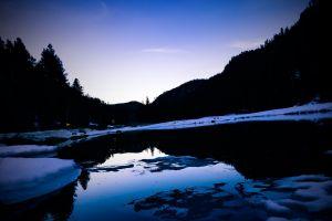 peaceful mountains frozen lake winter wonderland winter snow calm waters water sky sunset