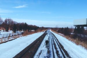 person cold freezing snowy walking railway railway tracks winter frosty train tracks