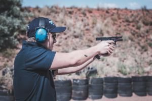 person shoot weapon man focus blur male firearm gun adult