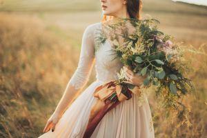 person woman grass field bouquet
