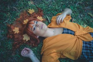 portrait photography female model orange color red hair forest