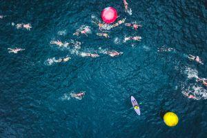 race wet kayak waves bird's eye view people water water sports action sea