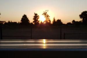 reflection sun evening bench sunset