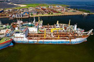 sea bird's eye view aerial shot drone shot pier industry harbor port watercraft transportation system