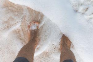 sea wet foam beach seashore water sandy sand feet